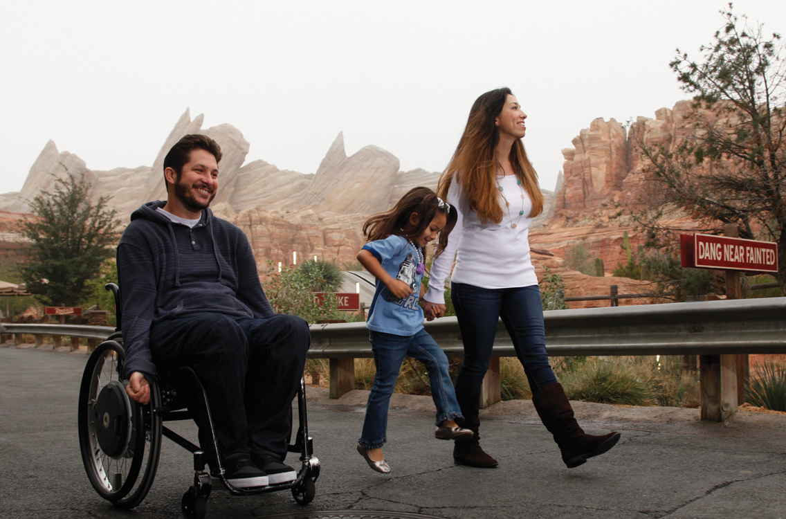 Andrew Skinner and his daughter, Betty, and wife, Kirsten, happily explore Disney's California Adventure. Photo by Scott Brinegar/Snaps Studio.